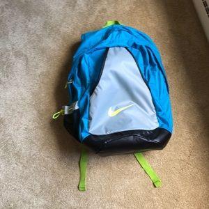 Blue and green NIKE backpack
